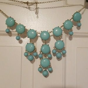 Turquoise colored bubble statement necklace.  Adj